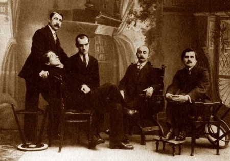 "This famous ""alogical"" portrait of five Russian Futurists was taken in St Petersburg in December 1913 and depicts, from left to right, Mikhail Matiushin, Alexei Kruchenykh, Pavel Filonov, Josif Shkolnik and Kazimir Malevich."